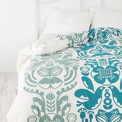Laerke Duvet Cover - Inspired by mid-century European folk art, this bedspread would look just as good whether you're enjoying a summer Christmas or are snuggling up with your hot chocolate.