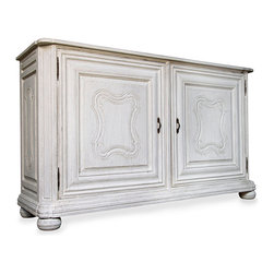 Kristianse Sideboard - White Weathered - Old-world carved details and a clean whitewash finish suffuse your dining room with upscale, noble European grace. These touches make the Kristianse Sideboard, a beautiful mahogany furnishing that stores and displays treasured pieces or serves as an elegant buffet when entertaining, a flawlessly upscale choice for any home's collection of luxury furnishings.