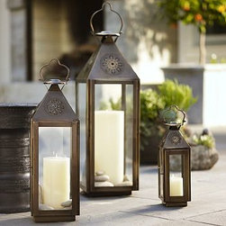 "Fez Star Punched Metal Lantern, Large, Bronze finish - Hung from branches or garden stakes, multiples of our lanterns mimic a starry sky. Small: 4.75"" wide x 4.5"" deep x 13"" high Medium:7.5"" wide x 7"" deep x 22"" high Large: 10"" wide x 9.5"" deep x 30"" high Made of stainless steel with a bronze finish. Glass panes."