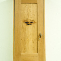 """Eastern Mentor One-Of-A-Kind Wall Cabinet - This handcrafted, CVG, (clear vertical grain), Ponderosa pine and Douglas fir cabinet is a subtle reminder of what is revealed when we open God's creation. The case is 31"""" tall X 16"""" wide X 7 ½ """"deep. The book matched knotted panel reminds some folks of Siddhartha, or some Taoist monk. Inside are three adjustable shelves, a clean and bright display for keepsakes. It has a handle cut from a broken and healed tine of a mule deer. The finish is a distilled French polish and an antique pine tinted wax. A similar creation would be priced out between $450.00 and $1200.00, depending on the species of timber chosen, the size, grain structure and patterns in those species."""