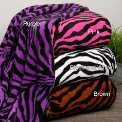 Plazatex - Zebra Microplush Blanket - Take a walk on the wild side when you cuddle up under these zebra print microplush blankets. Each blanket is oversized and incredibly soft to provide all the comfort you need while you read a book,watch a movie,or sleep the night away.