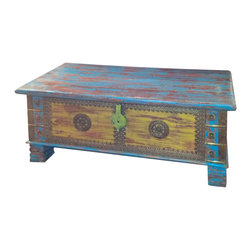 Everybody's Ayurveda - Large Distressed Wooden Trunk - Large Distressed Wooden Trunk. Mango Wood and MDF. Made in India. Hand painted with a distressed finish, the red, blue and yellow hues are complimented with brass accents and a medallion centerpieces in the panels. Perfect for storing bedding, photo albums and more!Package Includes:Wooden Trunk OnlyDimensions:Width: 45 inch