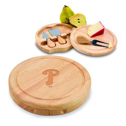 "Picnic Time - Philadelphia Phillies Brie Cheese Board Set in Natural - The Brie cheese board set is the perfect sized accessory for a small party or get-together. The board is a 7.5"" swivel-style, split level circular cutting board made or eco-friendly rubberwood that swings open to reveal the cheese tools housed under the board. The three stainless steel cheese tools have rubberwood handles. Tools included are a hard cheese knife, a chisel knife (hard crumbly cheese), and a cheese fork. A carved moat surrounds the perimeter of the board which helps to prevent brine or juice run-off. The Brie makes a delightful gift.; Decoration: Laser Engraved; Includes: 3 Stainless steel cheese utensils (1 hard cheese knife, a chisel knife (hard crumbly cheese), and cheese fork) with wooden handles"
