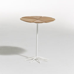 "Knoll - Richard Schultz Petal End Table - Petal End Table  designed by Richard Schultz  from Knoll  At A Glance:   Richard Schultz designed the Petal Table in 1960 as a companion piece to the Bertoia Chairs that were so enthusiastically received by the design-minded public. With a tabletop made from eight separate petals mounted on a cast aluminum ""spider"" bracket, the Petal End Table distinctly resembles the Queen Anne's Lace flower that inspired Schultz.  What's To Like:   MoMA loved the Petal Tables when they came out - they grabbed them as soon as they were introduced.Each ""petal"" expands and contracts with the weather independently from the other petals, protecting the top from cracks.Yes, the table can be used outdoors!The table has an exceptionally sturdy base due to its many legs.  What's Not to Like:   We really can't pick on anything besides price, since beauty is in the eye of the beholder. This is an expensive table, no doubt.  The"