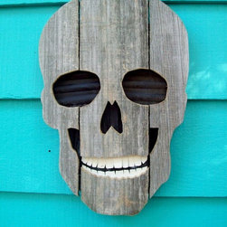 Upcycled Fence Wood Skull by John Birdsong - Finding Halloween decorations for my front step is hard — I have picky tastes, I guess. But this up-cycled skull is so awesome! I think it'd be perfect.