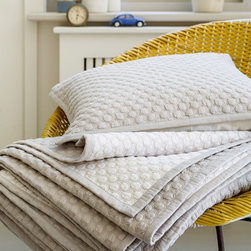 Christy - Christy of England Loop Throw - Linen - 120005546334813720 - Shop for Throws from Hayneedle.com! The Christy of England Loop Throw - Linen is a heavily textured blanket featuring a creamy white color contemporary embroidery and a soft handle. Modern yet casual this beautiful throw would look fabulous draped over any bed but it's so warm that you'll likely find yourself swaddled in it as you sit on the couch! The throw is machine washable but wash deep colors separately. Using detergents containing brighteners will affect the throw's shade. Measures 85L x 85W in. to cover almost any bedding and meet your cozy comfort needs.About Christy LifestyleAmazing how something so soft could have such an incredible impact on the world. In 1850 Henry Christy procured a small sample of looped pile fabric unseen in the Western World. He and his brother Richard Christy were taken with the delicate feel and incredible absorbency of the material and soon learned ways of reproducing the loop pile mechanically. The mass-produced terrycloth was an instant sensation that even Queen Victoria ordered in abundance. One hundred sixty-five years later the Christy name is still at the height of luxury home interiors and stands as England's premier retailer of everything from exquisite homewares to famous Egyptian cotton towels. Christy has even become the official towel supplier of Wimbledon.