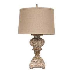 Carved Italian Vessel Lamp - Warm, stylish grandeur marks the Italian Vessel Lamp, a gorgeous transitional lighting option with base detailing modeled on the neo-Classical architecture and ornamental designs of the Italian Renaissance.  Its finish is a multi-layered artisan coating incorporating russet and cream for an antiqued stone appearance, while its shade is made from natural linen and has a sleek drum shape that lets the base show its magnificent quality.
