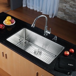 Kraus - Kraus KHU100-32-KPF2220-KSD30 Single Basin Undermount Kitchen Sink with Faucet - - Shop for Kitchen from Hayneedle.com! Sophisticated in style and design the Kraus KHU100-32-KPF2220-KSD30 Single Basin Undermount Kitchen Sink with Faucet is ready to keep your kitchen running smoothly. An arching faucet easily doubles as a strong sprayer while the integrated soap dispenser is always at the ready. The oversized basin is made to last from stainless steel and offers more than enough space to get the job done.Product SpecificationsBowl Depth (inches): 10Weight (pounds): 32Low Lead Compliant: YesEco Friendly: YesMade in the USA: YesHandle Style: LeverValve Type: Ceramic DiscFlow Rate (GPM): 2.2Spout Height (inches): 8.25Spout Reach (inches): 9.25About KrausWhen you shop Kraus you'll find a unique selection of designer pieces including vessel sinks and faucet combinations. Kraus incorporates its distinguished style with superior functionality and affordability while maintaining highest standards of quality in its vast product line. The designers at Kraus are continuously researching and exploring broader markets seeking new trends and styles. Additionally durability and reliability are vital components at Kraus for developing high-quality fixtures. Every model undergoes rigorous testing and inspection prior to distribution with customer satisfaction in mind. Step into the Kraus world of plumbing perfection. With supreme quality and unique designs you will reinvent how you see your bathroom decor. Let your imagination become reality!