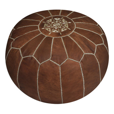Moroccan Tan Leather Pouf - AMoroccan artisans skillfully hand-stitches each pouf with care and craftsmanship that has been passed down from generation to generation. The North African pouf has traditionally been used as a low table where tea is usually served. Add a piece of culture to your home or instant color wherever you place it. We offer a variety of styles and colors to choose from. Add one of our sophisticated poufs to dress up a room or a fun pouf to add a pop of color to a kids room. Each pouf is hand stuffed with a special technique to hold its shape using a specific cotton/polyester blend.