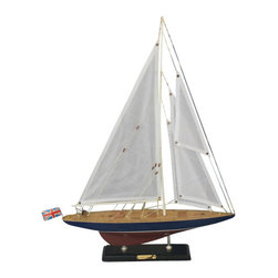 Handcrafted Nautical Decor - Endeavour Limited 20'' - NOT A MODEL SHIP KIT--Attached Sails and Endeavour model yachts are ready for Immediate Display-- --Newly redesigned, our Limited Edition sailing ship model of the famous America's Cup challenger Endeavour feature significantly upgraded deck features and increased craftsmanship. Still actively sailing and racing today, Endeavour will take you away with the wind and waves in these Limited Edition model yachts. Perfectly sized for any bedroom shelf, sunroom mantle or office desk, this high-quality yacht model is adorned with finely-crafted features and graceful lines.--14'' L x 3'' W x 20'' H----    Authentic      museum-quality scale replica of the real      Endeavour racing yacht--    Individual plank      on frame      construction of the hull using fine quality woods, with each plank and      wood grain visible through the paint--    Finely stitched cloth sails--    Limited      production run of these model yachts--    Pre-assembled, simply attach the masts and      display--    --        Ready to display in less than       five minutes--        Separate pre-assembled hull       and sails ensure safe shipping and lower cost--        Insert mast in designated hole       and clip brass rigging hooks as shown in illustrations--        Sails and rigging already       complete--    --    --