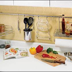 Wall-Mount Storage System - There's something about making the most of under-utilized space that makes me feel super efficient. This wall-mounted storage system, which fits on the kitchen backsplash (or the laundry room, or wherever else your tidy little heart desires), is a great idea.