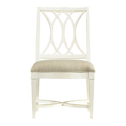 Stanley Furniture - Coastal Living Resort Heritage Coast Dining Side Chair - This Heritage Coast Dining Chair with it curving waves along the back conjures up days of sailing around Cape Hatteras, the brisk wind blowing in your face just enough to take your breath away and make your sails billow. You look for the lighthouse as you round the Cape, its barber pole pattern easy to spot in black and white. Recall your latest adventures while chatting with friends around the dinner table, a few of these side chairs keeping your rapt audience comfortable. Each chair has a wood frame with an open back design and connecting U-shape stretcher. The accommodating Super Comfort seat is upholstered in Solana Sand fabric with a welt edge. Eight finish choices all reminiscent of a day at sea