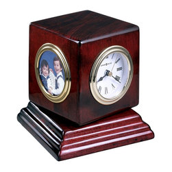 """Howard Miller - Howard Miller - Reuben Table Top Clock - A great way to celebrate family and the hour, this multi framed desktop timepiece. Great golden finishes encircle each panel of this rectangular complementary accessory. Show off the hour and the smiles of your family members with this on your table. * The cube easily turns on the rosewood finished base to feature the hygrometer, thermometer, clock and picture frame. . The three dials are white with triple rim, brass tone bezels and black numerals. . A full felt bottom protects your desktop. . Your clock will come packaged in a burgundy gift box. . Finished in Rosewood Hall on select hardwoods and veneers. . Quartz movement includes battery. . H. 4-3/4"""" (12 cm). W. 4-1/2"""" (11 cm). D. 4-1/2"""" (11 cm)"""