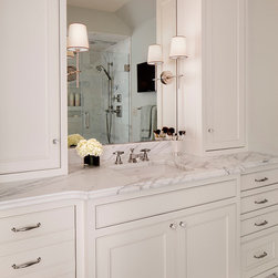 "Chic First Floor Remodel - The master bathroom also features ""his and her"" vanities with custom cabinetry, Calacatta marble, quality fixtures, and ample storage."