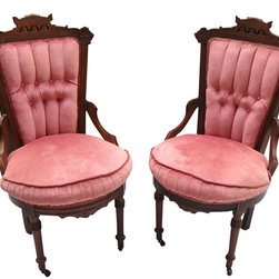 """Consigned Antique Victorian Eastlake Velvet Chairs - A Pair - A pair of antique Victorian Eastlake chairs, fit for royalty! They have dark walnut carved frames, and are covered in a pink tufted velvet. They would add an intriguing aesthetic to any French Provencial, Art Deco or Hollywood Regency style space. 19.5"""" W x 26.0"""" D x 37.5"""" H"""