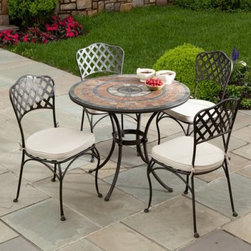 Asti Mosaic Patio Dining Set - Seats 4 - Treat yourself to a place to enjoy time with friends and family outdoors with the beautiful Asti Mosaic Patio Dining Set - Seats 4. Rich red hues accented by black tiles add a rustic yet sophisticated style to your patio. Featuring expert craftsmanship, the table frame is crafted from hand forged wrought iron dipped in a zinc-phosphate bath and E-coated to create a weather-resistant coating. It's finished with a powder coating to provide an extra layer of rust-resistant protection. Each mosaic tile on the table top is made from natural sources such as marble, slate, and travertine, and hand-set so no two tables are exactly the same. The top is then grouted with industrial adhesives for durability so the natural beauty of this table is maintained. Able to sit up to four people, you'll love having friends and family over for intimate meals, coffee, tea, and more. Each chair is fully welded so there is no hardware to loosen over time. A beautiful basket weave design on the back adds sophisticated elegance to each chair. Comfortable cushions in natural tones are included and give your patio a warm and inviting air while maintaining its luxurious look. An umbrella hole in the center gives you the option of adding an umbrella to provide shade during those sunny days and evenings, and also gives you a chance to accent the colors of this patio dining set. This table is also ideal for intimate dinners and gatherings with your favorite couple, or for a simple meal spending time with your family. Additional Features Features rich red hues with accenting black tiles Classic circle pattern Beautiful bistro chairs with a weave style back Table frame is weather and rust resistant Made with rust proof stainless steel hardware Iron has a thickness of 5mm to 6mm Mosaic tiles are hand-set Tiles come from natural sources Sources include marble, slate, and travertine Colors will vary slightly on each table No 2 tables are exactly alike Grouted wi