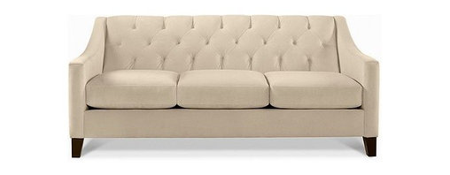 Chloe Fabric Sofa, Stone - Does everyone know about Macy's furniture? They are one of my go-tos for inexpensive pieces that don't sacrifice style. This ivory-colored sofa has a great tufted back and curved arms. It would also contrast darker accents beautifully.