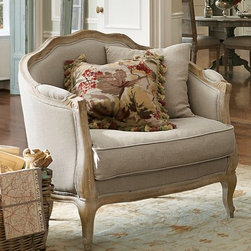 Adreanna Bergere Chair - This relaxed interpretation of classic Louis XV design marries inviting comfort with elegant structure. The hand-carved, solid oak frame is styled with a curvaceous camelback and cabriole legs, then whitewashed and wire brushed for a distressed patina. The flippable, down-and-fiber-wrapped seat cushion and throw pillows are upholstered in natural linen and accented with double-welt trim - a small detail that highlights the casual yet refined look we love. The chair is proportioned after the original French designs, which were sized just wide enough to comfortably support a lady and her petit chien.