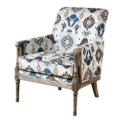 Dyani Armchair - Clearly charm doesn't take a back seat in the Dyani Armchair. The timeless feel of a brushed ikat pattern is accentuated by the soft coloration of earthen browns and sky blues, while the stripped-down finish layers on the carved arms and front posts suggest the gentle touch of time.