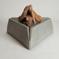 Triangulum Fire Pit - I love to warm up by the flames of an outdoor fire. Imagine a group sitting around this one that's made of durable composite concrete. It's both good looking and practical. The fire sits 10 inches off of the ground, above vertical slots that allow drainage and let in air to feed the flames.