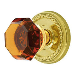 Amber Old Town Door Knob Set - Privacy, Passage and Dummy - This lovely door knob set features knobs made of hand-polished lead crystal paired with solid brass rosettes with the popular rope motif. The dazzling amber hue of each knob is magnified by the silver mirroring on the back side, which replicates true antique design.