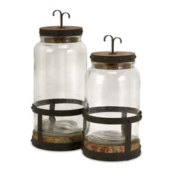 IMAX Worldwide Home - Sloan Lidded Canisters - Set of 2 - Set of two glass canisters with a rustic style base and lid. Containers-Glass. 14-16.5 in. H x 6.75 in. D. 41% Glass, 33% Firwood, 26% Iron