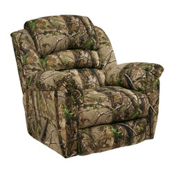 Catnapper - Catnapper High Roller AP Green Realtree Camouflage Chaise Rocker Recliner - 4712 - Shop for Recliners from Hayneedle.com! It may be covered in camouflage but there's no disguising the comfort of the Catnapper High Roller AP Green Realtree Camouflage Chaise Rocker Recliner. Covered in fabric upholstery with a camouflage nature-inspired print in tones of brown and green this rocker recliner features plush cushioning throughout full-reclining mechanism and pocketed coil cushion seating for support durability shape and comfort.The wall-hugger design allows you to place your recliner within inches of the wall allowing greater flexibility in your space. The Direct Drive crossbar means there's no side-to-side tilt and the 8-gauge sinuous steel spring system provides strength comfort and flexibility. The reclining mechanism offers smooth precise and quiet operation while the steel seat box and unitized steel base resist bending warping and splitting.Additional Features:Smooth quiet rocking mechanismmaked and assembled in the USAMedium cushion softnessReclining mechanism: full reclinerSpace-saving wall hugger style fully reclines within inches of the wallSeat dimensions: 20 x 21 inchesAbout Jackson Furniture (Catnapper creators)Started in 1932 Jackson Furniture has grown to be one of the largest family-owned living room furniture manufacturers in the world. Today Jackson Furniture Industries has a reclining furniture brand (Catnapper) and a mid-priced living room sofa brand Jackson Furniture. Through the years Catnapper has pioneered the development and manufacturing of many industry firsts: first recliner with a metal mechanism motion upholstery reclining sectionals X-tra Comfort and the Polaris System - an All Steel reclining system - built to last. Still family-owned and -operated Catnapper continues to lead the industry in comfort and value with its recliners and sectionals.
