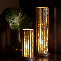 Hurricane Table Lamp - Small - Bring your accent lighting into the world of glamor when you include the Small Hurricane Table Lamp's reverse-gilded mirrors in your tabletop plan.  Pillar-shaped and modestly sized, it glitters in its own light as the bulb inside glows through the mirror panels, which are narrow bands leaded together for an architecturally upright, fluted column.  This transitional table lamp looks especially opulent when standing beside its larger twin.