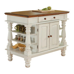 HomeStyles - Kitchen Island in White Finish - Distressed oak top. Rustic design elements appare in the strong lines of the raised panel doors. Hand applied. Storage cabinet accessible from both sides. Large and easy glide pass through drawer. Open storage shelves. Made from Asian hardwoods and veneers. Made in Thailand. 42 in. L x 24 in. W x 36 in. H. Assembly InstructionsStep into a comfortable surrounding that is Americana. This island is not only stylish but functional from both sides.