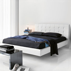 Cattelan Italia - Cattelan Italia | Franklyn Bed - Made in Italy by Cattelan Italia.The striking and inviting design of the Franklyn Bed fuses modern architecture techniques with simplistic modern silhouettes. This deluxe bed boasts a lushly upholstered leather body and rectangular headboard featuring elegant button tufting.  Stainless steel feet are discreetly tucked under the frame to give the appearance of floating, creating a relaxing airy feel that's ideal for a restful sleep.  Available in a two sizes, the bed comes with a multitude of leather color and texture options.  Sleeps two. Uses platform slats as mattress support. Mattress not included.