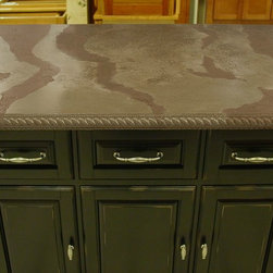 Concrete Counter Tops - This kitchen island top is made with concrete and has decorative rope edging for its profile