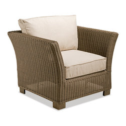 Thos. Baker - Sanibel Wicker Outdoor Club Chair - Crafted using fade-resistant nDuraA all-weather wicker hand-woven over powder-coated aluminum frames, each piece in the sanibel collection boasts a transitional style that compliments both contemporary and traditional outdoor spaces.Plush cushion sets are covered in premium Sunbrella outdoor fabrics made-to-order in your choice of 24 solid and textured colors or 16 premium woven patterns.Signature or premium cushion sales are final and ship in 2-3 weeks.