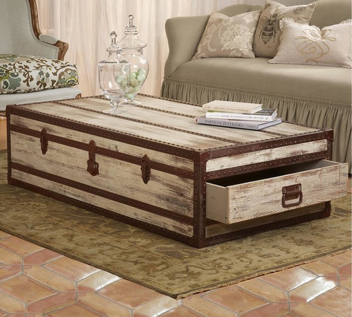 Abileen Trunk Coffee Table - An ideal combination of rustic beauty and functional storage, this trunk coffee table is constructed of slatted pine and bound with aged hand-forged iron joints to create a look that is casual and eclectic in turns. The trunk's storage takes a clever turn with two drawers that pull out from either side.