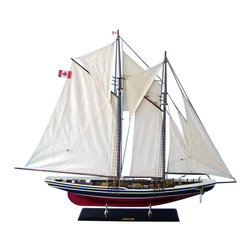 """Handcrafted Nautical Decor - Bluenose Limited 50"""" - Wood Sailing Yacht Model - Not a model ship kit. Attach sails and Bluenose yacht models are Ready for Immediate Display. Unmatched craftsmanship and attention to detail in this Limited Edition scale replica of the famous Canadian schooner make this model the Captain and envy of the Bluenose fleet. Commanding any room with the same winning spirit and hard-working attitude that won her decades of awards as both a racing and fishing vessel, this awe-inspiring model of the Bluenose is bedecked with museum-quality features and finely-crafted details. 50"""" L x 8"""" W x 38"""" H (1:40 scale)."""