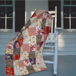 None - Amelia Quilted Throw - Create a look of comfort in any space with the Amelia floral quilted throw. The pale blue background and floral and plaid prints give a homey feel to the room. This throw is made from 100 percent cotton and can be washed right in the washing machine.