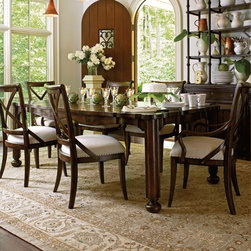 "Stanley Furniture - European Farmhouse Fairleigh Fields 7 piece Dining Set - STAN2981 - Shop for Dining Sets from Hayneedle.com! The European Farmhouse Fairleigh Fields 7 Piece Dining Set includes practically everything you need to create a warm and inviting dining space for gatherings large and small. This set includes the Farmer's Market Table four Fairleigh Fields Side Chairs and two Fairleigh Fields Arm Chairs. With its beautifully distressed hand-hewn plank tabletop scalloped edges and sturdy bun-foot legs this extendable dining table offers a fresh take on traditional European style. Designed to seat six people comfortably it has a 22-inch removable leaf that increases the length from 64 inches to 86 inches. Located at the end of the table a felt-lined utility drawer adds function to beauty providing a handy spot for serving utensils cloth napkins and other dining necessities. Four double-padded side chairs and two arm chairs showcase the timeless and elegant curves of Thonet bentwood. Supported across the back with bowed slats the curved design cradles your back and shoulders with smooth support. Each antique brass-rimmed SuperComfort seat is upholstered in oatmeal linen fabric. Made in the USA this premium-quality dining set is constructed of Dutch white cedar solids and veneers of white cedar and ash burl. It boasts a lovely weathered look due to its distressed finish which is offered in your choice of terrain or blond. Terrain is a rich hand-waxed coffee tone with artisanal distressing while blond offers a natural close-to-the-wood matte finish with cream-colored accent glaze. Dimensions Table: 64-86L x 44W x 30H inches Side chair: 20.25W x 23.75D x 39.5H inches Arm chair: 22.5W x 23.75D x 39.5H inches The European Farmhouse CollectionEach piece of this unique European Farmhouse collection looks and feels like a prized antique store find those once-in-a-lifetime discoveries that give your home its unique character. Eclectic accents and colors blend and complement each other like old friends without being too ""matchy."" Hand-waxed colors like dark coffee chalkboard black and honey blond enrich the Dutch white cedar veneer. Run your fingers across the silky sheen to feel the authentic antiqued distressing then tickle the Old-World dangle pulls as if this furniture has long been part of your family. Stanley Furniture CraftsmanshipStanley Furniture's main objective is to produce quality and stylish furniture by using the best wood materials construction procedures and elegant finishes on their products to help you fashion your home decor the way you imagined. All of their furniture is hand-crafted from quality woods incorporating other superior materials such as aluminum glass plastic leather and marble. Every joint is carefully constructed (keeping wood's sensitivity to heat and humidity in mind) allowing for expansion and contraction. All joints are held together with glue and nail. Stanley's 30-step finishing process starts with an undertone stain that is applied to a hand-sanded piece. Next the stain is sealed with a wash coat then hand sanded again with filler applied to pack the wood pores and smooth out the surface. A sealer coat is then applied the piece is hand sanded again and hand padded to mellow the tone. From there a luster glaze is rubbed on by hand followed by antiquing or distressing also done by hand. Finally after drying each piece is hand waxed and rubbed prior to final inspection. About Stanley FurnitureSince 1924 the goal of the Stanley Furniture Company has been to manufacture high quality furniture at a price the average American family could afford. To accomplish this goal founder Thomas Bahnson Stanley surrounded himself with the finest furniture craftsmen and instilled in them a sense of pride in building superb quality into every piece of Stanley Furniture. Today that pride is shared by more than 1 750 dedicated associates who have made Stanley Furniture one of the largest most respected furniture manufacturers in the nation."