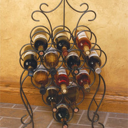 "J & J Wire - J & J Wire Victorian Wine Rack Multicolor - DP1020 - Shop for Wine Bottle Holders and Racks from Hayneedle.com! For a witty way to display your wine try the bunch-of-grapes-shaped J & J Wire Victorian Wine Rack. This clever wine rack stacks 13 bottles of wine in a grape-like configuration then adds a curly ""vine"" topper that doubles as a handle. Proudly made in the USA from wrought iron with a dark pewter powder-coat finish this freestanding unit is a fun yet functional work of art. About J & J Wire Inc.Located at the Industrial Park in Beatrice Nebraska J & J Wire Inc. started 25 years ago as a wire-forming business manufacturing mostly houseware items. Since then the company has grown into a metal fabrication business serving customers in many different manufacturing sectors in the United States and Canada. From quilt racks to wine racks J & J Wire is committed to creating handmade works of art at affordable prices."