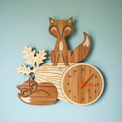 Fox Log Bamboo Wall Clock by Graphic Spaces - Mr. Fox, along with Baby Fox, could prove very helpful in teaching your little one how to tell time. This clock, with its laser-engraved design, could certainly become a family heirloom.
