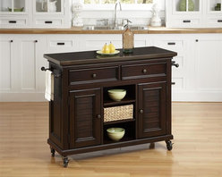 HomeStyles - Espresso Kitchen Cart - Inspired by the fusion of British colonial and old world tropical design, the Bermuda Kitchen Cart highlights poplar solids and veneers in a deep, Espresso finish. Further inspiration can be found in the shutter style designed doors and intricate details. Bounteous storage is provided with two cabinet doors with one adjustable shelf behind each door, three adjustable shelves in middle, and two storage drawers. Other features include 7mm thick uniquely antiqued stainless steel top to complement the matching hardware, two towel bars, and industrial sized casters (two locking). Beautifully accented with antique brass hardware. 44.5 in. W x 17.75 in. D x 32 in. H
