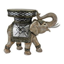 "Oriental Furniture - 20"" Standing Elephant Statue - Graceful and strong, this elephant marches in procession while carrying an inlaid table top on its back. Complete with a traditional circus costume that glitters in the light, this happy elephant will delight you and your guests. Standing at over fifteen inches and featuring a nearly ten inch surface area, this stunning statue is also a sturdy piece of furniture. Carefully carved in resin and painted with a masterful touch, this functional piece of art is sure to be a fun and exotic addition to your home decor."
