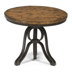 Magnussen Cranfill Round End Table - With a simple twist of the top, this Magnussen Cranfill Round End Table adjusts up or down. Plus, it has that ultra popular industrial look. This well-constructed table is weathered to perfection with a round top made of pine and hardwood solids in an aged finish. Its sturdy iron base has a weathered finish and threaded post that has that turn of the century feel. About Magnussen FurnitureFrom its beginning as a small furniture company in Ontario, Canada, Magnussen Furniture has evolved into a full-line furniture resource with offices in Canada, the United States, and the Far East. Their business is creating furniture designs of exceptional style, value, and beauty. They produce these designs in partnership with manufacturing partners around the world that meet exacting standards for superior quality at the best possible value.