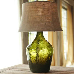 Clift Glass Bottle Table Lamp Base, Green - I love mixing glass and the texture of linen together. This stunning lamp from Pottery Barn is such a winner, and it will add both warmth and color to your space.