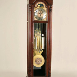 """Ridgeway Clocks - Ridgeway Hardwood Grandfather Clock with Bras - Traditional design features give this grandfather clock an air of strength and security, with an attractive Glen Arbor finish to ensure its good looks. The columns are reeded, making them as good-looking as they are strong. The weights are finished in shining brass, and easily visible through a beveled glass panel. * This traditional design with an elegant swan's neck pediment and fullyturned finial comes in a Glen Arbor finish and is made of selecthardwoods and veneers. . Reeded columns with upper and lower turnedcaps frame the dial.. The functioning moon dial with pierced stars, raised Arabic numeralsand embossed corner and center spandrels glimmer in the night with aninterior light.. Through the beveled glass of the front locking door and side glasspanels, brass finished weights shells and a lyre pendulum with amatching decorative 10 5/8"""" (270mm) disk, hang beautifully in front ofa mirrored back.. A cable driven movement that plays the Westminster chime features anautomatic night silence option.. H 85 1/2""""(218cm), W 23""""(59cm), D 18""""(46cm)"""