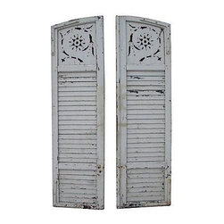White Vintage Wooden Shutters - This pair of beautiful, 1930's, 7' vintage wooden shutters comes from Pacific Palisades. With mortise and tenon construction and a desirable weathered and patina finish, these two have a tongue and grove closure and are heavy enough to be used as doors.
