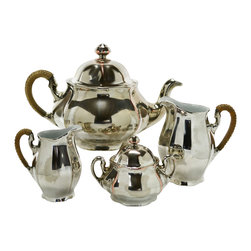 None visible - Consigned Silver Plated Porcelain Tea Set with Cane Handles, Vintage English - Spectacular tea set with a teapot, sugar bowl, creamer and milk jug, porcelain encased in a silver plated copper, handles lined with a woven cane; vintage English, first half of the 20th century.
