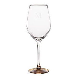 """Caroline Red Wine Glass, Set of 6, Gold - Toast the festivities with our elegant glassware, part of our new Caroline Registry Gift Collection. Master glassblowers in Poland create our delicate yet durable pieces, notable for their gold and silver bases. We've wrapped them in a beautiful gift box so they're ready to present on that special occasion. White Wine: 3"""" diameter, 9.5"""" high; 6 fluid ounces Red Wine: 3.5"""" diameter, 9.5"""" high; 10 fluid ounces Flute: 3"""" diameter, 10"""" high; 7 fluid ounces Made of blown glass. Set of 6. Hand wash. Monogramming is available at an additional charge. Gold is Catalog / Internet only. Packaged in a beautiful PB storage box. Made in Poland. Read more on our blog about the inspiration behind this product."""