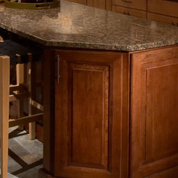 CliqStudios.com - Base End Angle - The base end angle not only allows for transition from 24? deep cabinets to 12? deep cabinets, but also allows designers to create visually appealing angles and better usage of traffic flow where space is tight.
