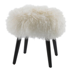 Wellington Sheepskin Ottoman - I swoon over ottomans, and this little guy is all sass and sophistication!