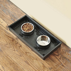 """Ballard Designs - Rubber Pet Food Tray with Bowls - Imported. Rinse Tray with hose to clean. Available in three sizes to accommodate all size pets. Our scroll relief Pet Food Tray turns kibble into a four-paw dining experience. Made of virtually indestructible black rubber with 2"""" high sides to keep spills contained and features the words """"Eat"""" and """"Drink"""" under their respective bowl placements. Stainless metal bowls fit snuggly into the molded rings and say """"More Please"""" in the bottom.Pet Food Tray with Bowls Features: . . ."""