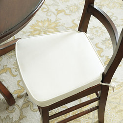"Ballard Designs - Provence Dining Chair Cushion - Available in our favorite go-to fabrics & colors. Zips off for easy seasonal change or cleaning. Matching fabric ties. 2"" deep foam core. We custom tailored this comfy Dining Chair Cushion to fit our best-selling Provence Chair. Back corners are notched to fit snuggly around the back rails, so there's less shifting and bunching when lingering over dinner. Front flares to follow the seat's contours.Provence Dining Chair Cushion features:. . . ."